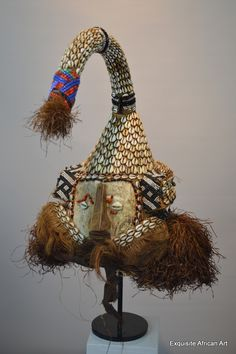 Mukyeem or Mukenge mask, Kuba Origin: Kuba Kingdom D.R.Congo Approx Age: Mid - Later 20th Century Materials: Animal skin, raffia, glass beads, cowrie shells, wood Dimensions cm: 52 tallest point x 26 widest point - Exquisite African Art
