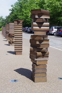 Statues of Piles of Books as bollards at Cambridge University Library - London, England;  bollards are short vertical posts originally used for mooring boats, but now used more in directing traffic;  photo by Martin H. Evans, via Bollards of London