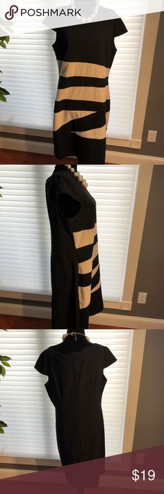Black and tan dress This dress has fun stripes across the front. Black background stripes are tan. Looks great Alone or with some additional accessories from your own closet. Pictured Necklace and belt not included. Alyx Dresses