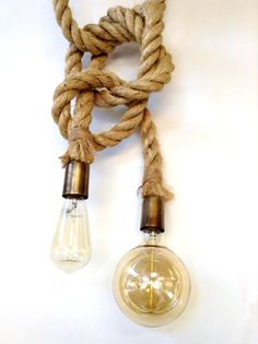 nAUTICAL ROPE with matte gold hardware pendant light and white leather can be hang either with a nautical knot or plain loose cable.    The standard