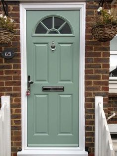 Perfect - green sunburst composite front door, white frame, chrome letterbox, knocker and handle. Exterior House Colors, Exterior Doors, Composite Front Door, Painted Front Doors, Outdoor Paint, Shutters, Tall Cabinet Storage, Craftsman Houses, Floor Plans