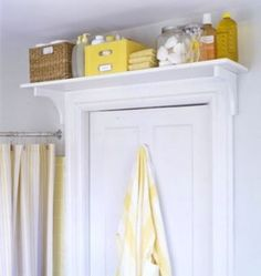 If you have any space above the door frame, take advantage of that as well. A shelf above the door will provide great out-of-the-way bathroom storage for extra supplies, many of which can be disguised in decorative bins, baskets, and glass jars.