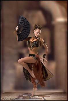 What a lovely photo. The way it's framed and everything makes her look like she's really tiny to me. Like, four inches tiny. I want a tiny bellydancer!