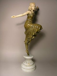 "Sold for $35,000- Antique Place. A VERY RARE AND FINE GILT BRONZE AND IVORY FIGURE TITLED ""RUSSIAN DANCER"" BY PAUL PHILIPPE (VERY WELL LISTED ARTIST). SIGNED P. PHILIPPE IN THE BASE. REFERENCE BRYAN CATLEY ART DECO AND OTHER FIGURES PAGE. 251. HEIGHT OF FIGURE 16"". MOUNTED ON A 4 3/4"" WHITE MARBLE BASE."