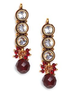Darkly bewitching, these drop earrings feature an alluring mix of crystal and onyx gemstones, some luxely framed with gold wire.