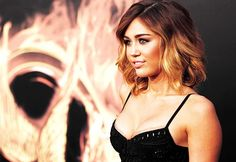 No, not a Miley fan, but like her short hair ombre, maybe start with red and fade to blonde?