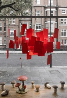Ingo Maurer Zettle'z chandelier w/ red paper (usually white w/ notes)