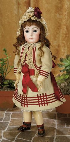 """14""""-French Bisque Bebe Triste, Rare Size 9, by Emile Jumeau in Original Costume~~~ Marks: 9 (head) Jumeau Medaille d'Or Paris (body). Comments: Emile Jumeau, circa 1884, the model is referred to as Bebe Triste in reference to its sad-faced expression. Value Points: the sought-after model here in rarest petite size 9, has beautiful expression and painting, original body and fine body finish, and superb original costume and matching bonnet, undergarments, socks, and shoes."""