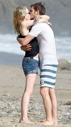 Emma Stone shows off shrinking frame in cheeky expletive T-shirt as Andrew Garfield turns 29