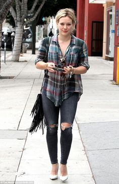 On a rip: Hilary Duff, 27, was spotted shopping in Hollywood on Wednesday while wearing ri...