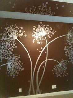 I painted a metallic flower on a plain brown wall.....so modern and simple!!