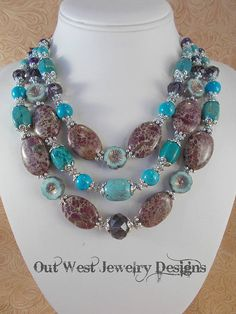 Take a look at this gorgeous, chunky, triple strand, western style cowgirl necklace!! I put it together using some plum purple variscite ovals that have a beige background, purple howlite rounds, turquoise howlite rounds, six sided barrels and a focal barrel, faceted grape purple Chinese crystal rondelles and some turquoise colored Czech glass flower beads that have a purple/gold antiquing to them. Lots of nice Tibetan silver spacer beads and bead caps. The necklace is finished with knot...