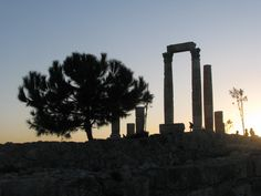 The Citdael in Amman, Jordan, at sunset Amman, Seattle Skyline, Trees, Characters, Sunset, Photography, Photograph, Tree Structure, Figurines
