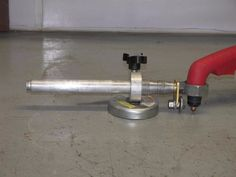 Circle Cutting Jig by KHK -- Homemade circle cutting jig constructed from a surplus tripod, magnetic base, nuts, bolts, and a dielectric union. http://www.homemadetools.net/homemade-circle-cutting-jig-19
