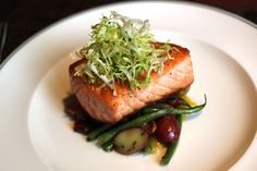Salmon is brain food. Also? Delicious. The Henry pan roasts their fish and serves with applewood smoked bacon, green beans, yukon gold potatoes and a sherry-shallot vinaigrette. Yum!