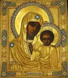 A VERY FINE antique Russian icon of the Kazanskaya Mother of God, 1890, Moscow, naturalistically painted on a wooden panel, overlaid with gilded silver and cloisonne enamel oklad (riza).