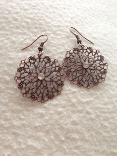 copper filigree earrings with a silver diamond