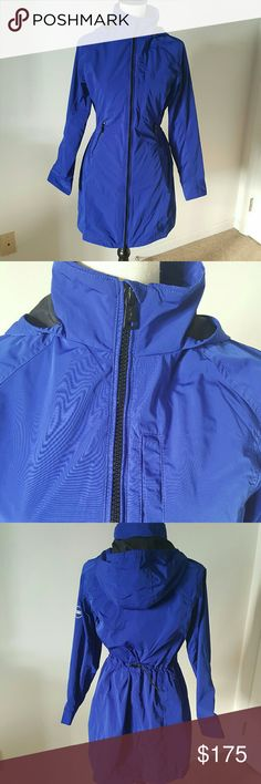NWT Ralph Lauren Active Galaxy Blue Rain Jacket Get ready for Spring! Treat yourself to a new, bold - colored rain jacket!  New With Tags (NWT). Never worn!!   Has a string in the back to tighten the waist.   No trades! Ralph Lauren Jackets & Coats