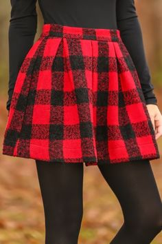 Red and black plaid skirt with pleat detail! We are OBSESSED! The absolute perfect skirt! The question is where would you not wear this?! LOVE!