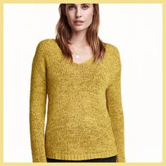 H&M Knit Sweater Long-sleeved, V-neck sweater in a loose, ribbon-yarn knit with a gently rounded hem. The color is greenish yellow something like olive oil. 62% acrylic, 38% nylon. Machine wash warm  Art.No. 29-1103  Imported- Made in China H&M Tops Blouses