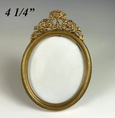 """Antique 4.25"""" Tall Oval French Miniature Frame, Dore Bronze, Easel Stand or Hang Antique Frames, Oval Frame, Old Ones, Easel, It Cast, Miniatures, Bronze, French, Rock Shower"""