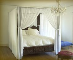 """Triple Arch Jhula #CanopyBed is modeled after the swings from the Maharaja's court. The entire bed is hand carved from Indian White Rosewood, with 6"""" carved pillars made from solid pieces of hardwood, reaching up to engraved beams. #IndianBedding #IndianBedroomDecor"""