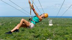 Showing item 1 of 5. Woman on a zipline at Xplor park in Cancun