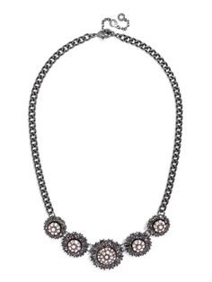 The stars have definitely aligned to create this gorgeous crystal disk necklace with shimmering rings of crystals.