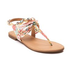 From the streets to the beach, you'll love the Sandy Sandal from SHI by Journeys! The Sandy Sandal flaunts a strappy canvas upper with gold-tone chains, beads, and charm embellishments. The adjustable ankle strap allows a secure fit and the textured rubber outsole provides flexible traction.