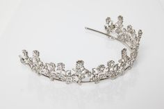 Magnolia: You will feel like a Southern belle with this delicate pattern of silver plated flowers adorned with Swarovski crystals. Rose of tiny blossoms sparkle on a silver plated tiara.