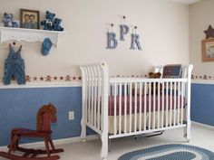 This boy's mother wanted to incorporate items from generations past into this nursery. The teddy bears on the shelf are custom-made from her grandfather's favorite sweater, and there is an old photo of the grandfather with his twin brother as young boys.