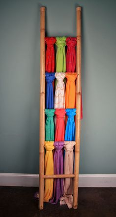 A simple bamboo ladder can give a novel feel to a scarf display. Scarves can be tied or draped over bars to create different looks!