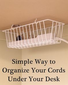 Using a metal kitchen basket under your desk to store your power strip