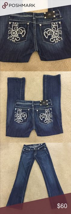 """🌷Miss Me #JP5033 floral fleur de lis boot-short 🌷Miss Me #JP5033 floral fleur de lis dark boot. Size 29-short. This is a stunning pair of Miss Me jeans that runs just a little small for my taste. They look great on the rear and so pretty! I love these jeans!!! Preloved in excellent condition. Factory distressing on front pockets. All crystals and rivets intact. Waist lying flat is 15"""". Rise is 7.5"""". Inseam is 29.5"""". Outseam 38"""". Professional hem. Boot is 8.5"""". Miss Me Jeans Boot Cut"""