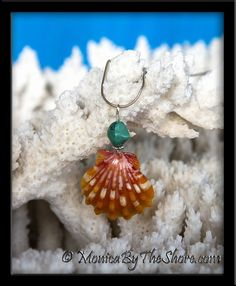 Sun & Sea colors! Bright orange Hawaiian Sunrise Shell with Turquoise nugget necklace! This gorgeously colored Sunrise Shell is the perfect match for the five Sunrise Shells and Turquoise bracelet (see the Bracelets page) and the Sunrise and Turquoise earrings (see Earrings page). The Sunrise Shell measures 1 1/8 inches of pure perfection in color and shape! The seashell and turquoise nugget pendant dangles from an 18 inch sterling silver snake chain. An eye catching piece full of Aloha!