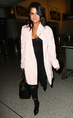 Selena Gomez touches down at LAX in a fierce coat!
