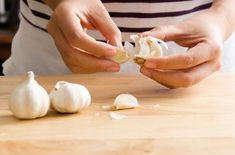 Photo about Woman peeling garlic by hand for cooking. Image of ingredient, gourmet, garlic - 93341603 How To Peel Garlic, Rubbing Alcohol Uses, Garlic Peeler, Garlic Bulb, Food Lists, Korean Food, Food Hacks, Helpful Hints, Onion