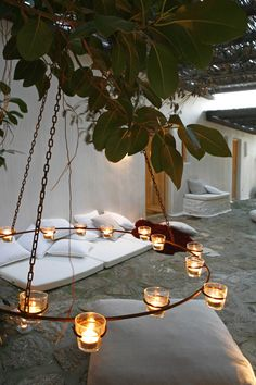 Outdoor Living: use a candle chandelier suitable for the garden, to warm up cool evenings.