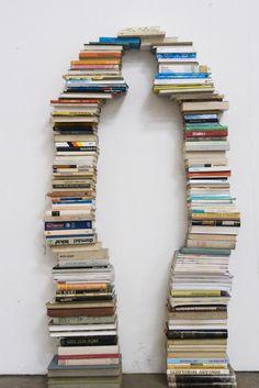 Negative space plus books. - #BookArt #Sculptures #AlteredBooks #Photographs #BookDesign #BookPaper #BookSculptures #Installation #RecycledBook #Bookish