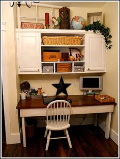 love old window and crate on top of cabinets.. also the shutter!