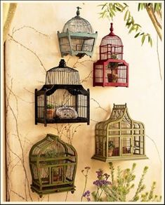 Unique Bird cages... Could hang a bird cage on the porch so long as the door is torn off or securely tied back! Let them build a nest inside!! :)