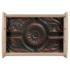 This serving tray is decorated with an image of a beautiful artistic wood carving in shades of brown, gold, mahogany and black. A central abstract circular flower pattern has petals radiating out to a carved circle which is surrounded by four sections. Each section has abstract leaf carvings.
