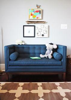 Joanthan Adler mini sofa - via Little Green Notebook: Room Tour: Fletcher's Nursery (son of Chassity from Look Linger Love)