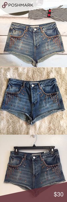 """TOPSHOP Moto Studded High Waisted Denim Shorts Topshop Moto high Waisted Studded Denim Shorts. Size W28. Measures 14"""" flat at waist, 11"""" front rise, and 1"""" inseam. Can be styled for a Boho festival look or more of an alternative punk style.  #topshop #trendy #studded #denim #highwaisted #shorts #hipster #moto #punkydoodle  No modeling Smoke free home I do discount bundles Topshop Shorts Jean Shorts"""