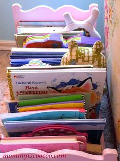 mommy is coo coo: How to Decorate a Transitional Girl Bedroom Love this idea to use a doll bed for books!