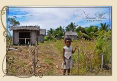 Village and a little girl in Ile Sainte Marie, Madagascar