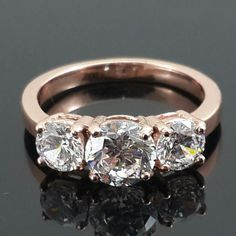 18ct Solid Rose gold  AAAAA grade cubic zirconia three stone ring