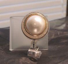 vintage pearl badge reel