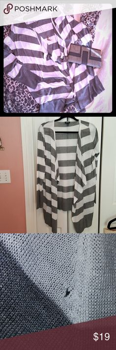 Striped Cardigan Striped white and gray cardigan with open front flowy detail. Small hole in right sleeve, see pic above, otherwise in excellent used condition. Very lightweight and somewhat sheer. torrid Tops