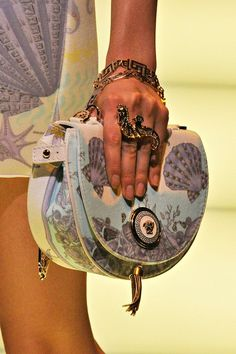 Versace, love the motif and how the ring ties in with the bag.